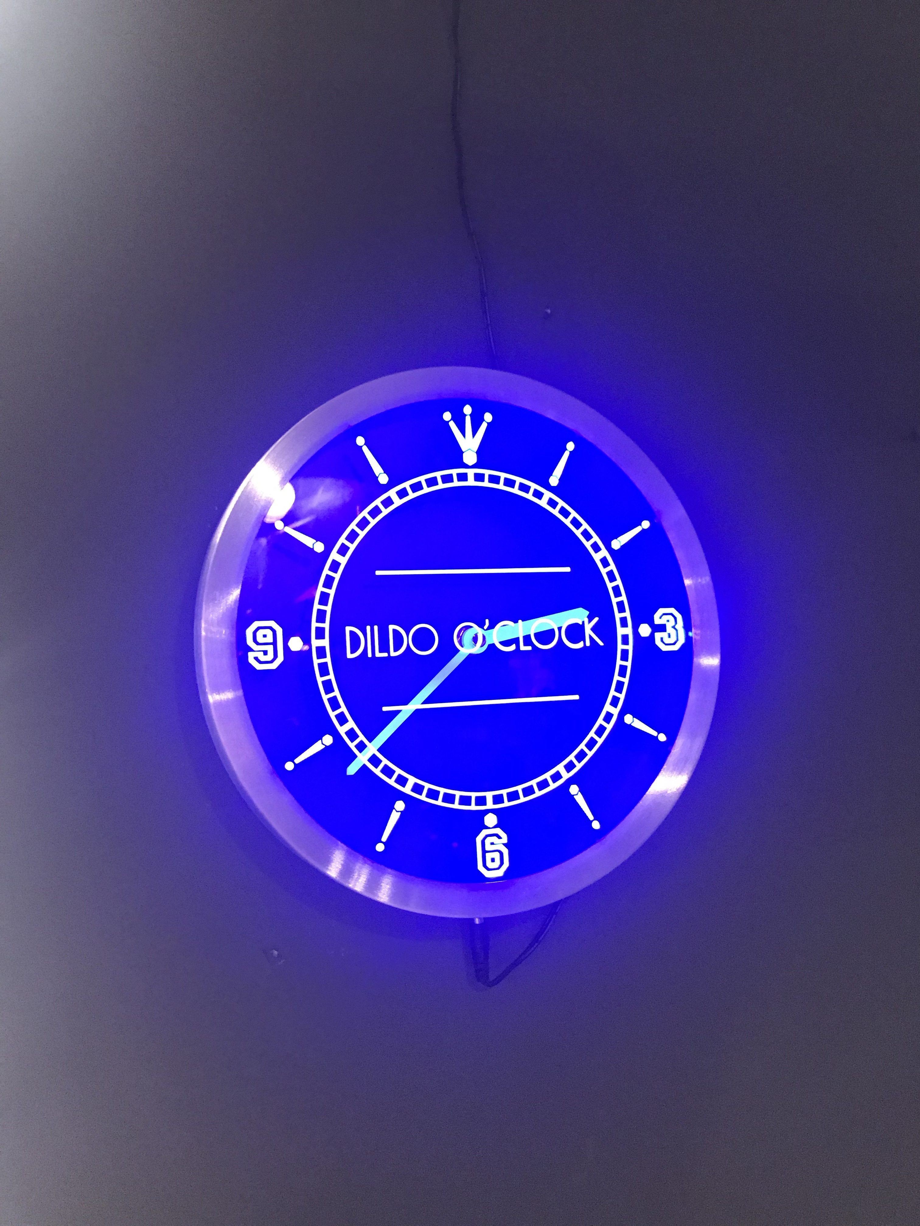 blue glowing clock that says Its Dildo O'Clock