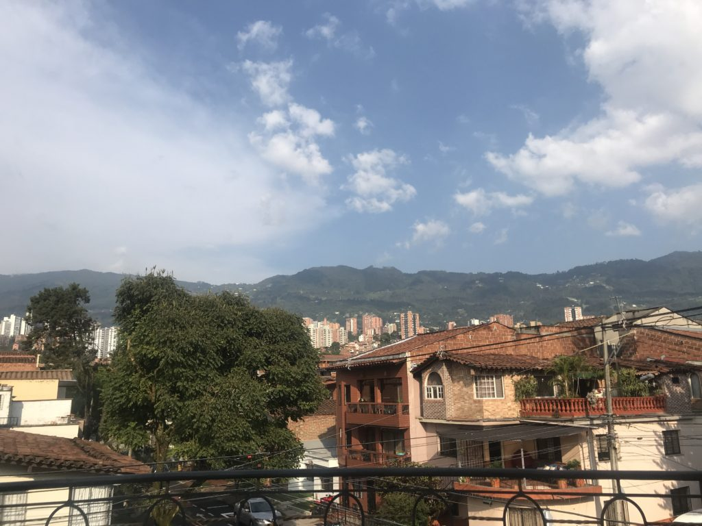 Scene from a large balcony on and out onto the mountains in Medellin