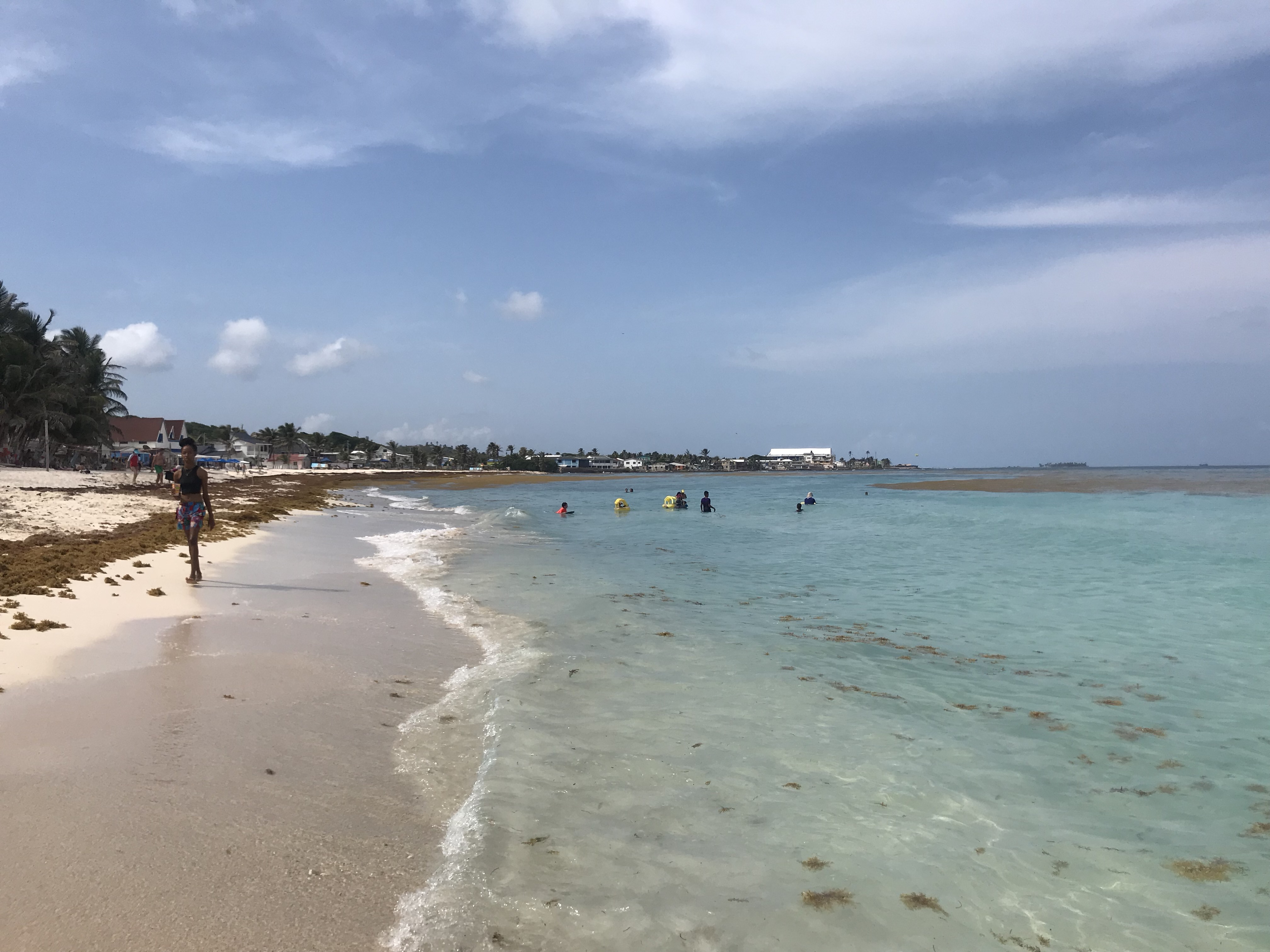 Beach with green aqua clear water