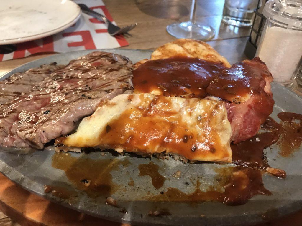 dinner with pork, chicken, steak with BBQ sauce