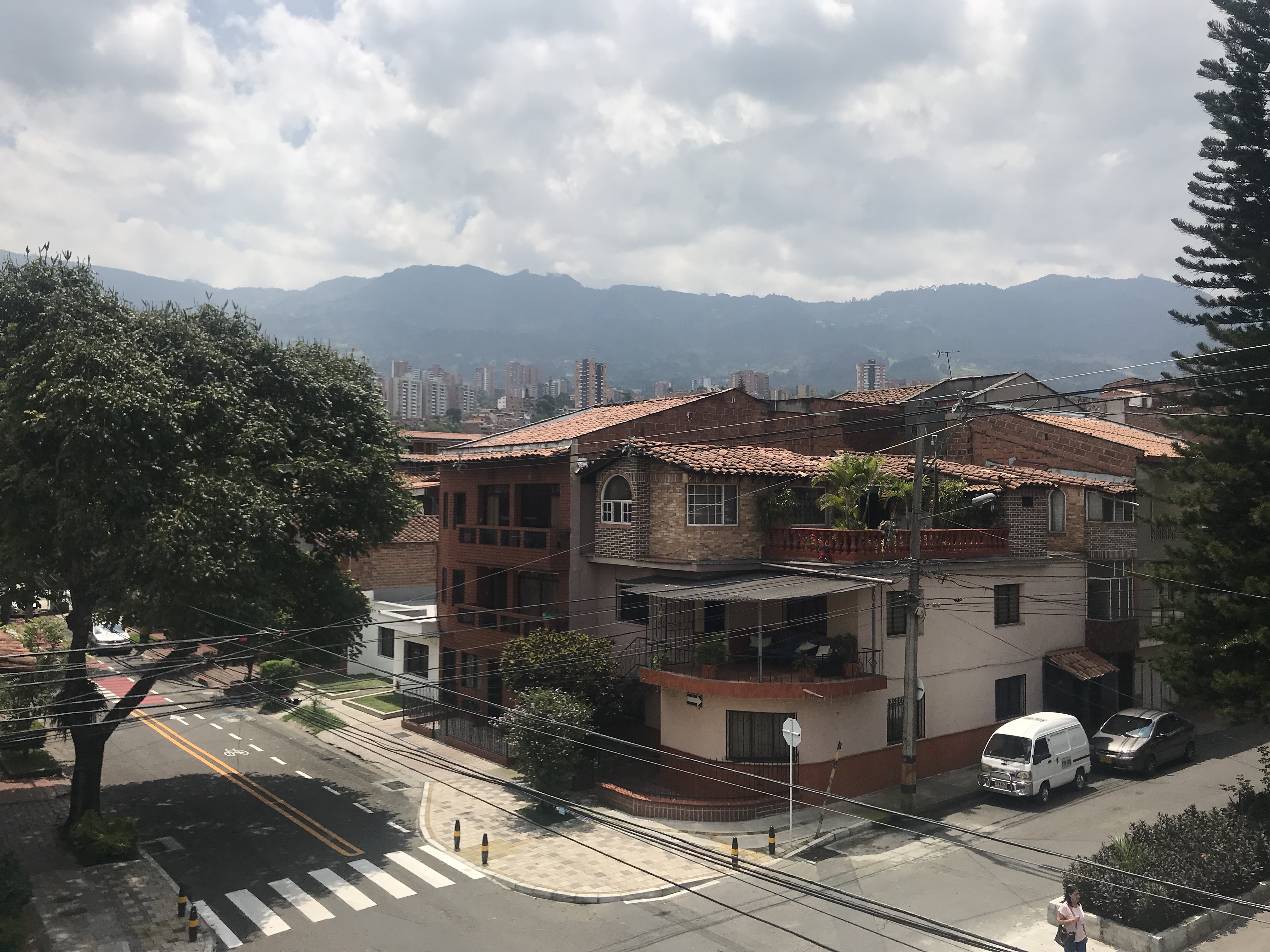 Daytime scene of the hills of Medellin from behind a neighborhood home