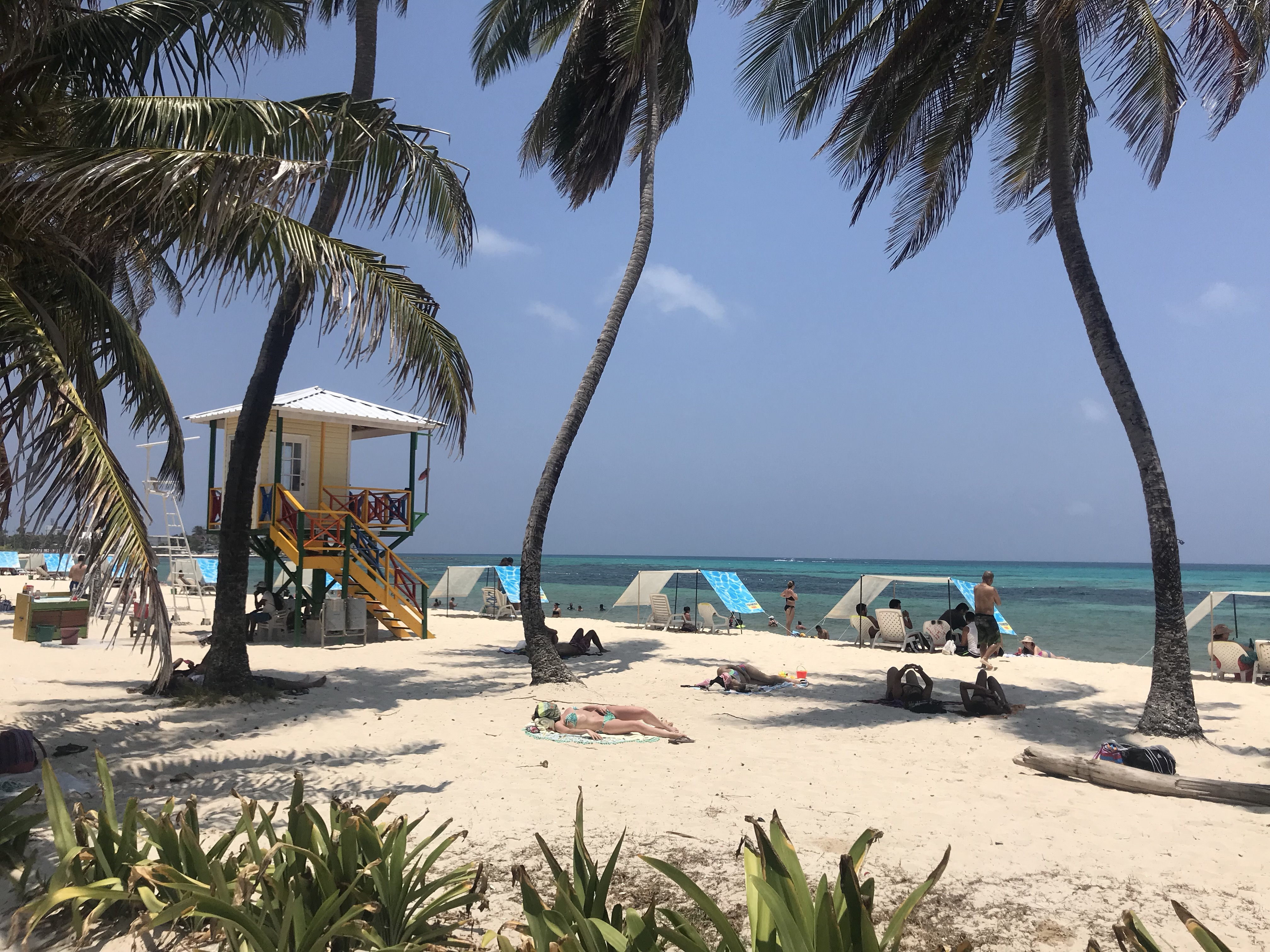 White sand beach with bright lifeguard post