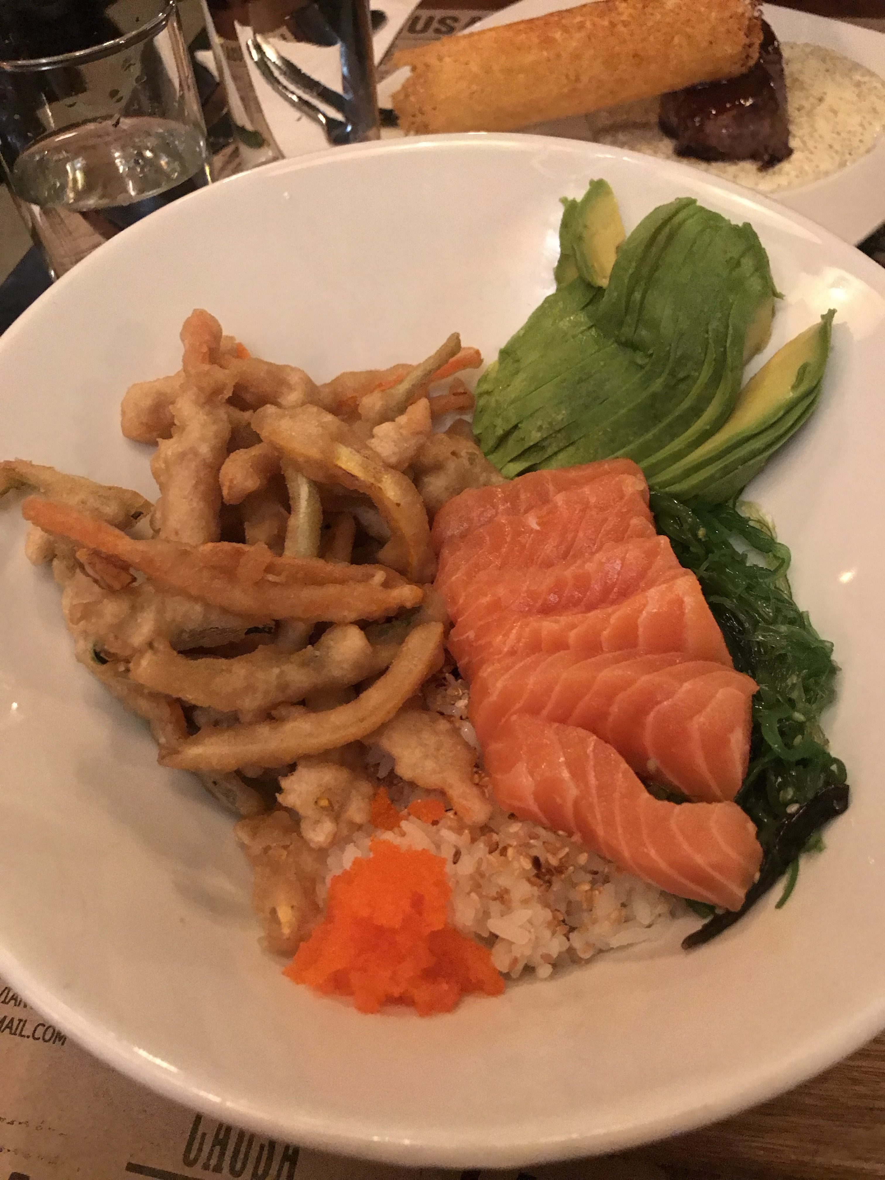 Peruvian Japanese poke bowl with shashimi salmon and rice