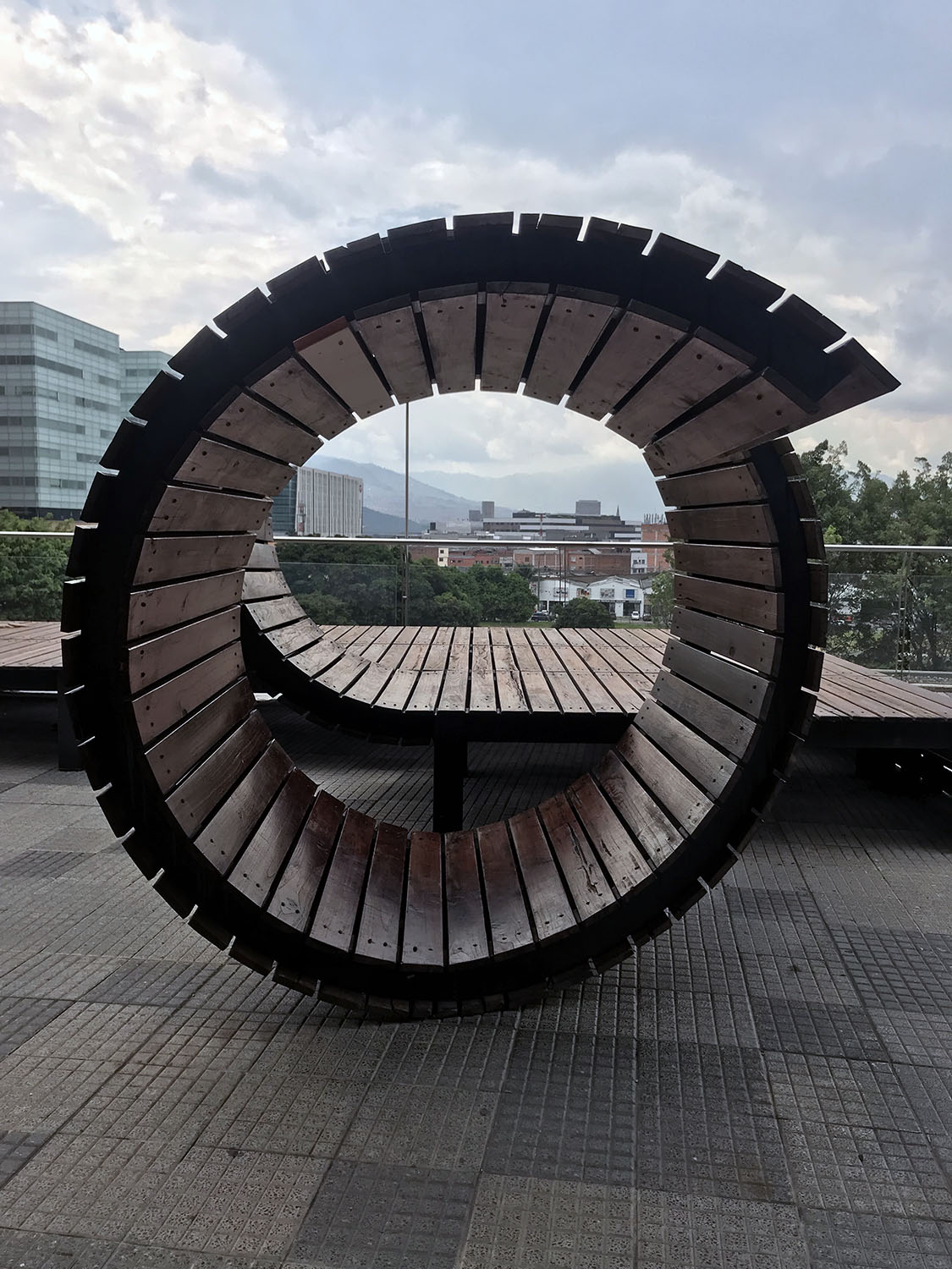 circular sculpture with the mountains behind it