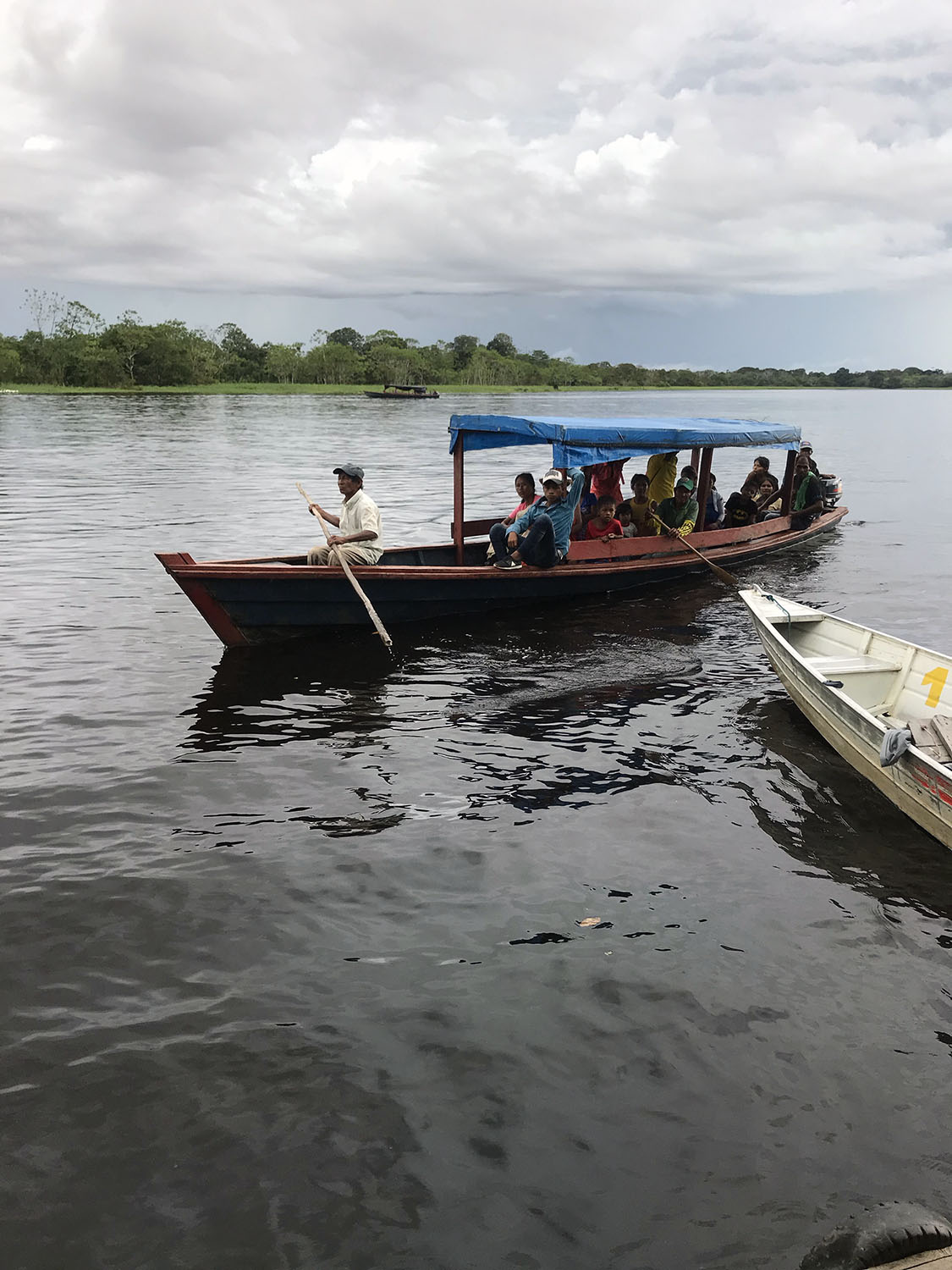 Small boat full of people commuting like a bus on the amazon river