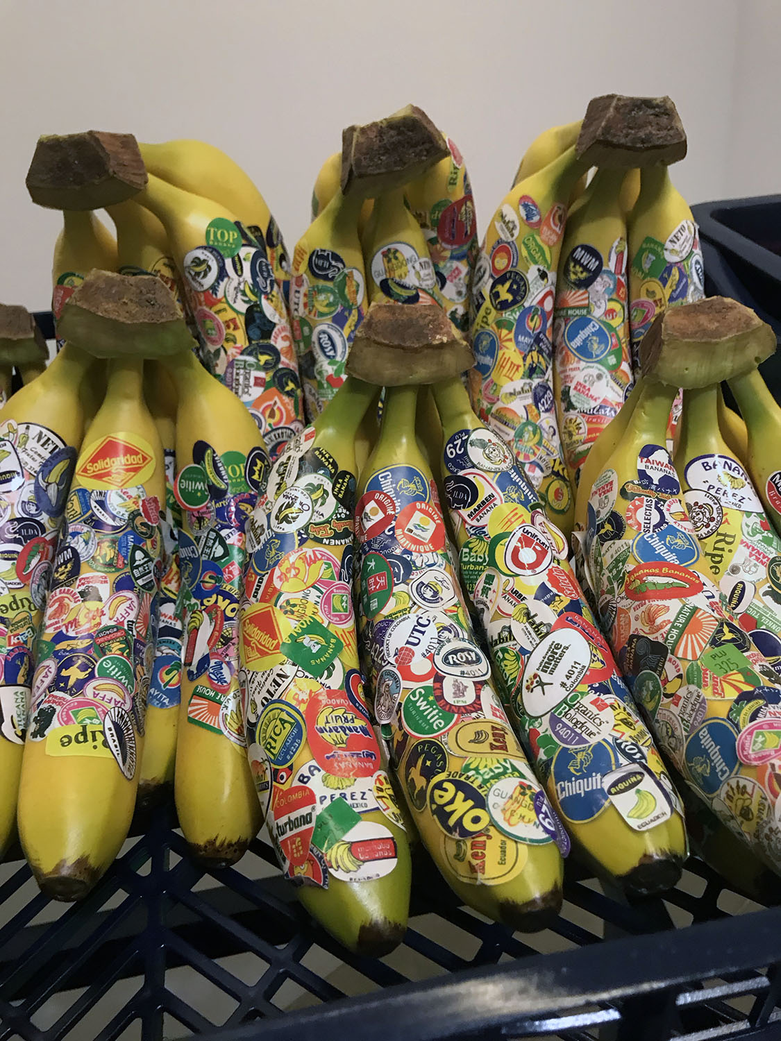 Bananas with a LOT of stickers on it