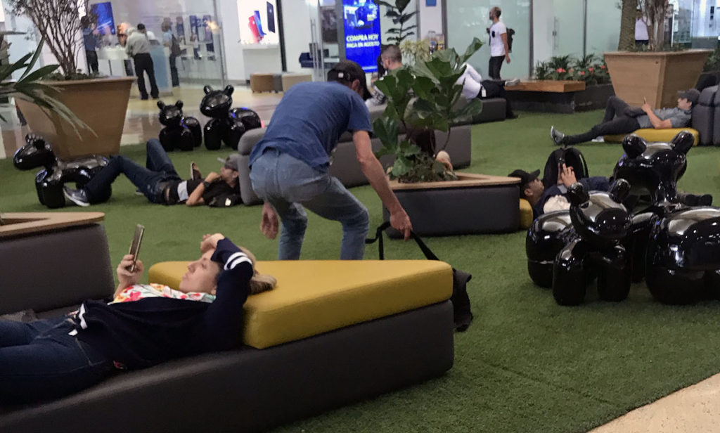 people lounging on the floor at the mall
