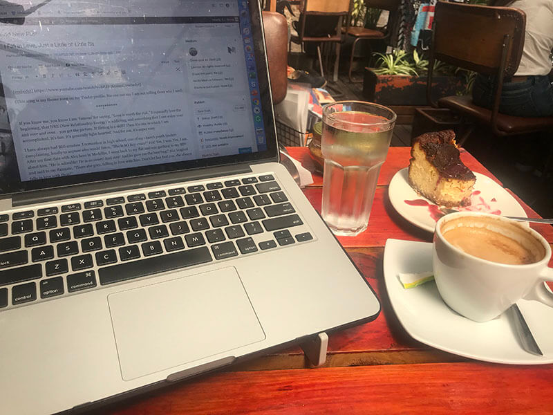 Laptop, coffee, and cheese cake