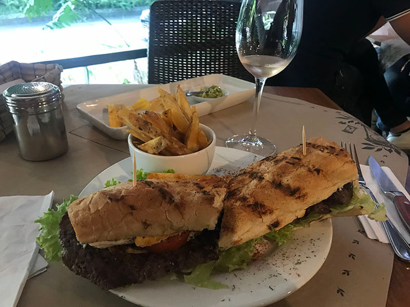 Yummy steak sandwich, French fries and rose wine.