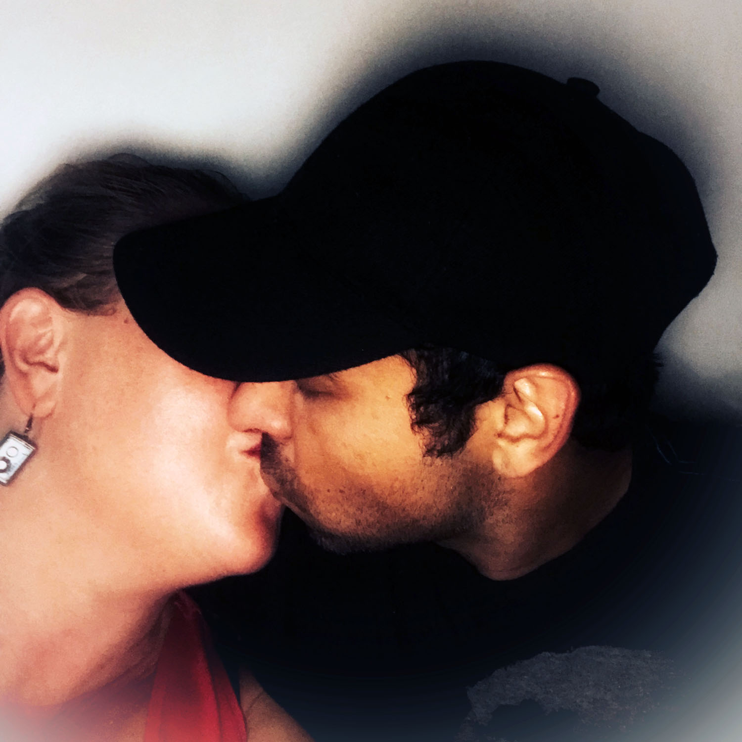two people kissing but you can only see the sides of their faces