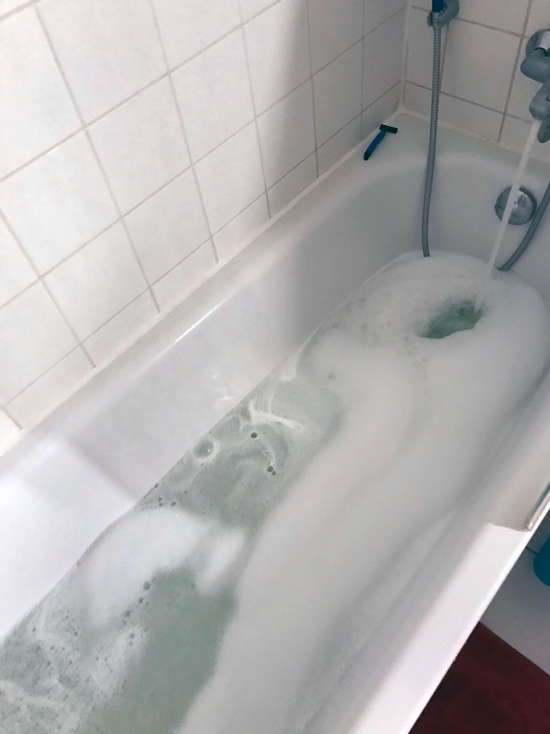 Empty bathtub with bubbles