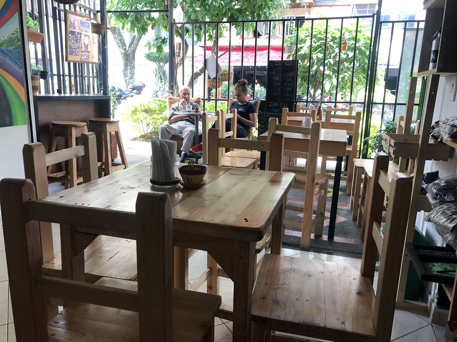 small local cafe with wooden chairs and tables
